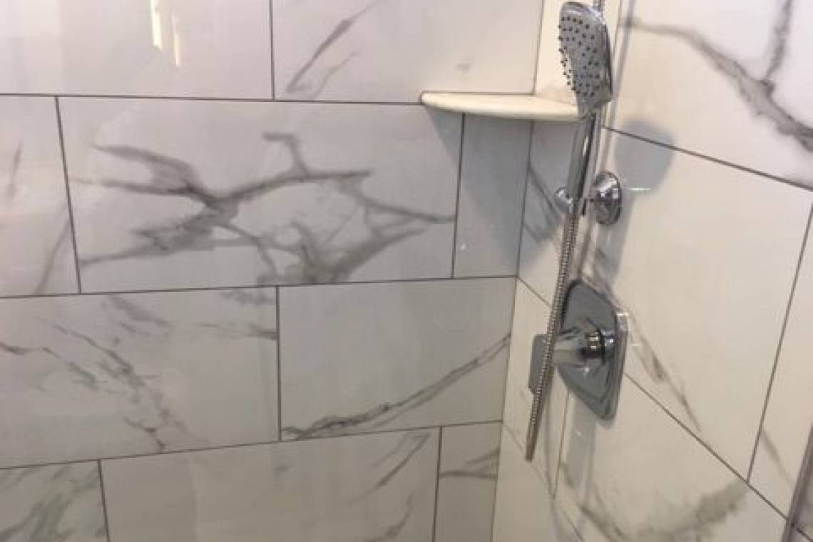 Faux Marble Tile In The Walk In Shower Remodeling Contractors